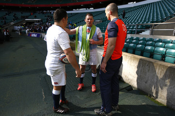 England's Dylan Hartley, England coach Steve Borthwick and Jamie George during training