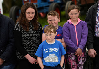 Sarah Coakley, Ciaran Coakley, Eolann Coakley and Meghan Coakley watch as William Ford Jr., Executive Chairman of Ford Motor Company arrives at his great-grandfather Henry Ford's ancestral home in Ballinascarthy