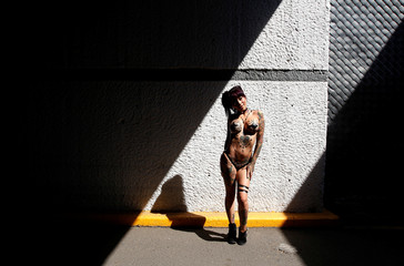 """Exotic model known as as Esmeralda Vandalik poses for a photograph after a news conference to promote the """"Expo Sex and Eroticism"""" adult exhibition in Mexico City, Mexico"""