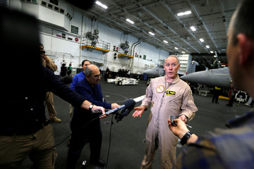 Commander, Carrier Strike Group TWO Rear Admiral Kenneth Whitesell, speaks to media on board the U.S. aircraft carrier, USS George H. W. Bush after transiting the Strait of Hormuz