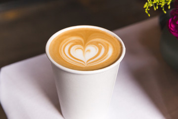 Coffee in Paper Cup with Heart Design