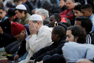Muslims pray during Friday prayers in the street in front of the city hall of Clichy, near Paris