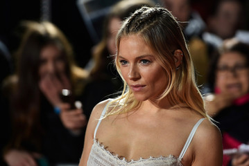 """Actress Sienna Miller poses at the premiere of the film """"The Lost City of Z"""" in London"""