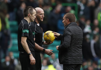 Celtic manager Brendan Rodgers with referee Bobby Madden after the match