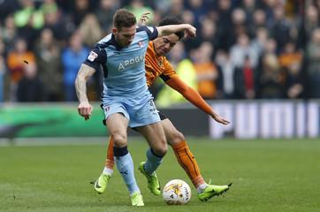 Wolverhampton Wanderers' Helder Costa and Rotherham's Joe Mattock in action