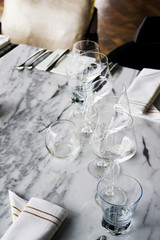Glasses on Table set prepared for dinner