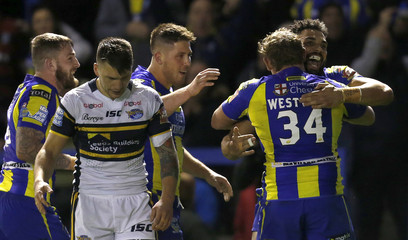 Ryan Atkins (R) celebrates scoring the second try for Warrington Wolves