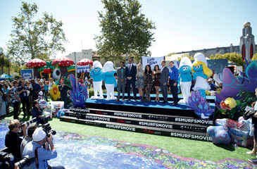 """Cast members Danny Pudi, Joe Manganiello, Meghan Trainor, Demi Lovato, Ariel Winter, Jack McBrayer and Jeff Dunham pose with Smurf characters at the premiere of the film """"Smurfs: The Lost Village"""" in Culver City, California"""