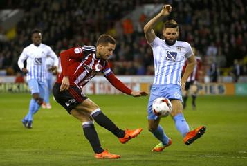Sheffield United's Billy Sharp in action against Coventry City's Jordan Turnbull (R)
