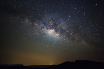 Milky way galaxy with stars over moutain at Phu Hin Rong Kla National Park,Phitsanulok Thailand, Long exposure photograph.with grain
