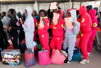 Illegal African migrants arrive at Mitiga International Airport before their voluntary return to their countries, east of Tripoli