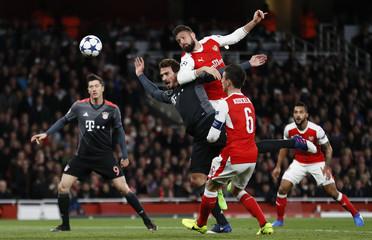 Arsenal's Olivier Giroud heads at goal
