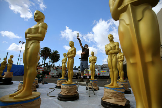Stage craft artist Rick Roberts gives Oscar statues a fresh coat of gold paint as preparations begin for the 89th Academy Awards in Hollywood