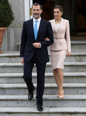 Spain's King Felipe and Queen Letizia walk down the stairs as they wait for the arrival of Argentina's President Macri and first lady Awada before their lunch at the Zarzuela Palace in Madrid