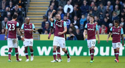 West Ham United's Andy Carroll celebrates scoring their first goal with teammates