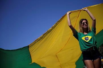 A woman takes part in a protest in support of Lava Jato investigation in Rio de Janeiro