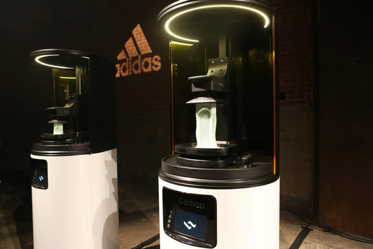 Carbon 3D printing machines are seen at an unveiling event for the new Adidas Futurecraft shoe in New York City