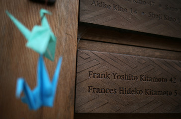 Origami cranes hang near names of some of the 227 people who were marched off the island to camps, at the Japanese American Exclusion Memorial on Bainbridge Island