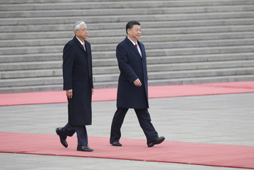 Myanmar's President Htin Kyaw and China's President Xi Jinping attend a welcoming ceremony in Beijing