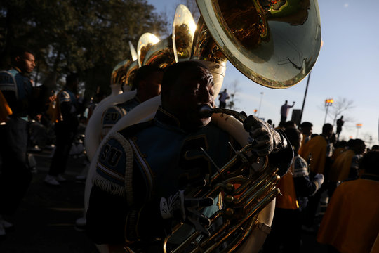 A high school marching band plays before the start of the Bacchus parade during Mardi Gras in New Orleans, Louisiana