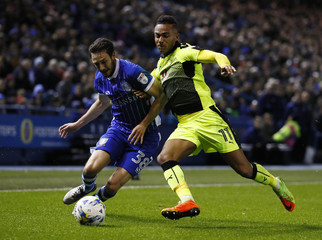 Sheffield Wednesday's William Buckley in action with Reading's Jordan Obita
