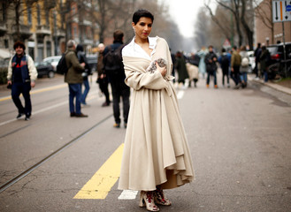 Saudi Princess Deena Aljuhani Abdulaziz, director of Vogue Arabia, poses before the Fendi's Autumn/Winter 2017 women collection during Milan's Fashion Week, in Milan