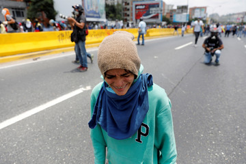 A demonstrator rallies against Venezuela's President Nicolas Maduro's government in Caracas