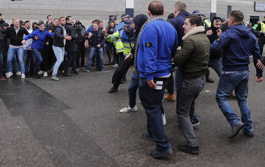 Police and fans clash outside the stadium before the match
