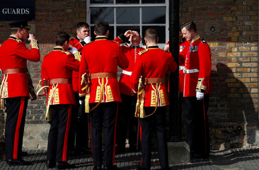 Members of the Irish guards prepare for a visit by Britain's Prince William and Catherine the Duchess of Cambridge to mark St Patrick's Day at their barracks in London