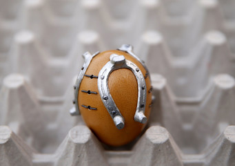 An egg decorated with small horseshoes is seen in a workshop in Kresevo, Bosnia and Herzegovina