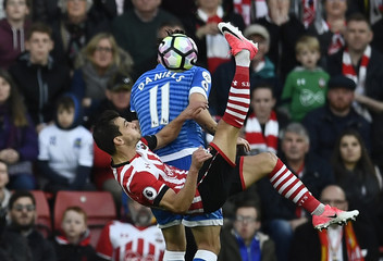 Southampton's Cedric Soares in action with Bournemouth's Charlie Daniels