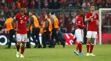 Bayern Munich's Arturo Vidal, Douglas Costa and Thomas Muller look dejected after the match
