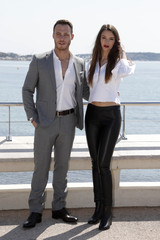 "Actress Leyla Lydia Tugutlu and actor Kerem Bursin pose during a photocall for the television series ""Heart Of The City"" at the MIPTV, the International Television Programs Market, in Cannes"