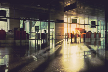 Silhouette of an empty airport security gate during sunrise. Travel Concept. Vintage colors