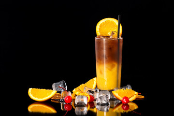 Closeup glass of fresh orange juice mixed with coffee at black isolated background.