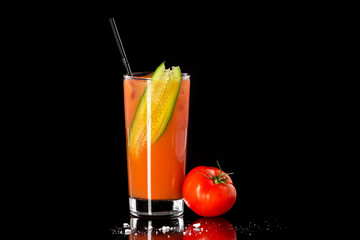 Fresh glass of tomato juice isolated at black background as concept oh healthy lifestyle.