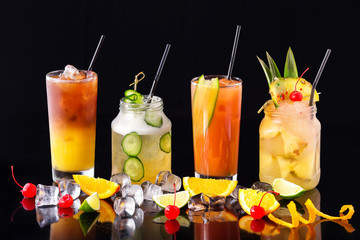 Group of fresh summer cocktails at isolated black background.