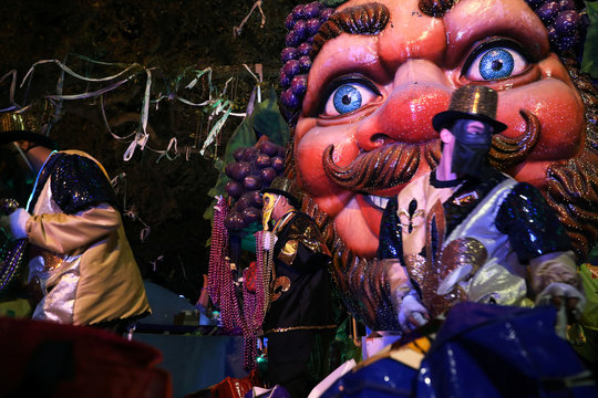 Float riders throw beads at the Bacchus parade during Mardi Gras in New Orleans, Louisiana