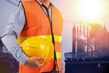 engineer holding protection equipment on site  background
