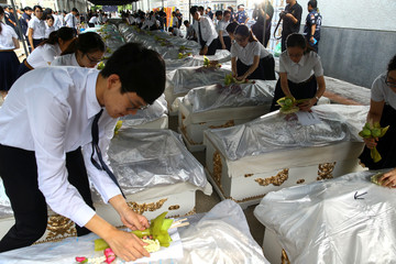 Medical students from Chulalongkorn University take part in a religious ceremony to pay respects to cadavers used during their medical studies before the bodies are removed from Chulalongkorn Hospital in Bangkok