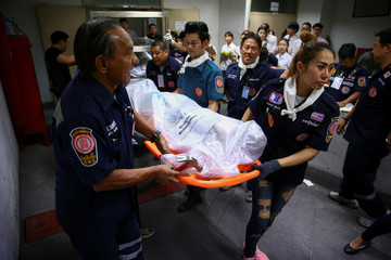 Rescue workers from Poh Teck Tung Foundation carry a cadaver during a religious ceremony to pay respects to cadavers used for medical studies before the bodies are removed from Chulalongkorn Hospital in Bangkok