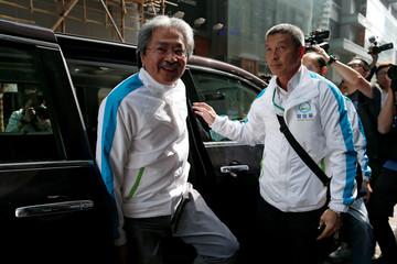 Chief Executive candidate and former Financial Secretary John Tsang alights from a vehicle during an election campaign in Hong Kong, China