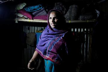 Rohingya Muslim refugee Sanmaraz describes her story in front of Reuters TV camera inside her room in the Leda Unregistered Refugee Camp in Teknaf, Bangladesh