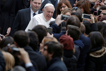 Pope Francis is welcomed by students as he arrives to attend a meeting at the University Roma Tre in Rome