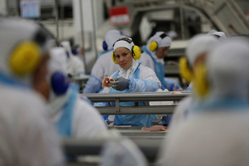 Employees work during a technical visit of Brazil's Agriculture Minister Blairo Maggi at the Brazilian meatpacker JBS SA in the city of Lapa
