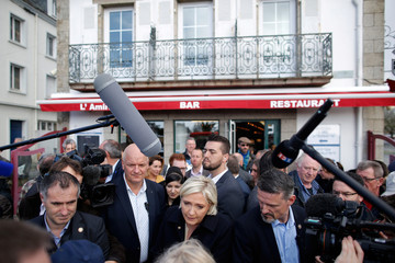 Marine Le Pen, French National Front (FN) political party leader and candidate for French 2017 presidential election talks to a resident as she visits a market in Concarneau