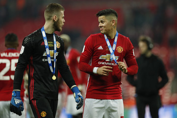 Manchester United's David De Gea (L) and Marcos Rojo celebrate winning the EFL Cup Final