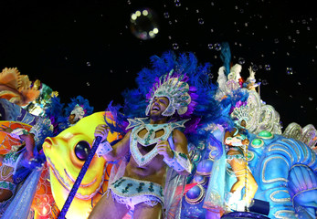 Revellers from Uniao da Ilha samba school perform during the second night of the carnival parade at the Sambadrome in Rio de Janeiro