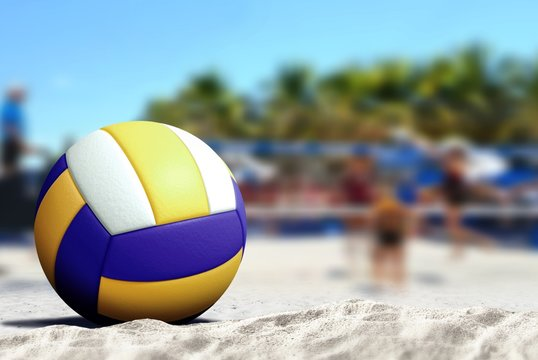 Volleyball game on sandy beach