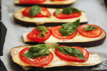 Grilled food and additives with tomatoes basil and eggplant